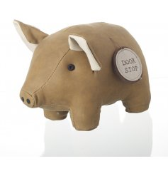 This simplistic little sitting piggy door stop will bring a tanned trend to any home
