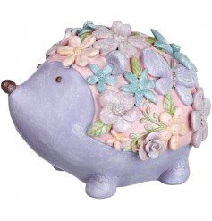 An adorable little hedgehog inspired money bank