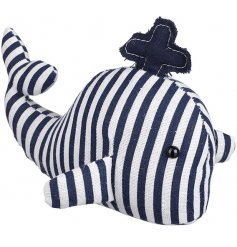 A funky little striped whale paperweight that will bring a trendy coastal charm vibe to its space