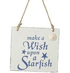 Bring a touch of the ocean to your home with this chic hanging wooden plaque