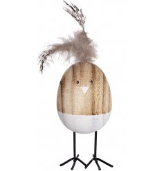 A funky little wooden egg decoration, complete with a feathered hairdo