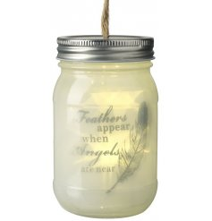 A beautiful LED filled mason jar with a script 'Feathers appear when angels are near""