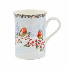 A Christmas mug featuring robins and holly