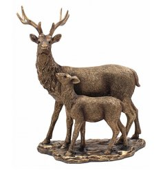 A bronzed resin ornament of a deer and fawn
