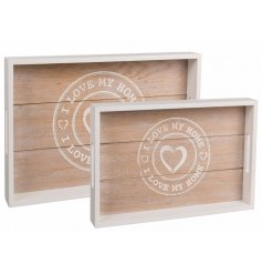 A white wished and natural toned set of wooden ' i love my home ' trays
