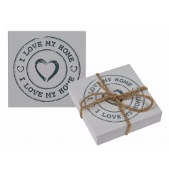 A shabby chic inspired set of wooden white washed coasters complete with a large scripted ' i love my home '