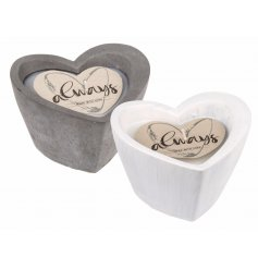 This sweet assortment of white and grey cement candle pots will look perfect in any home space