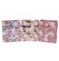 An assortment of 3 les fleurs medium gift bags