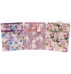 An assortment of 3 les fleurs large gift bags
