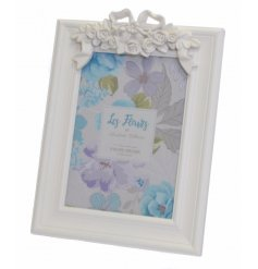 A shabby chic inspired floral effect picture frame,