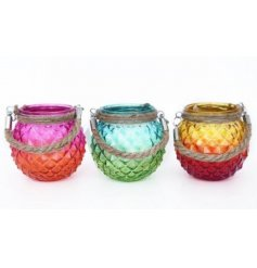Bring a touch of the tropics to your home space with this groovy assortment of glass candle pots