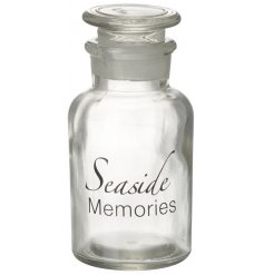A glass bottle with seaside memories quote
