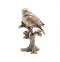 A bronzed resin robin ornament