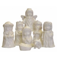 Add a sweet traditional set of glazed white nativity pieces to your home this christmas
