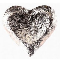 A chic embossed metal heart bowl, perfect for any home inspired looks