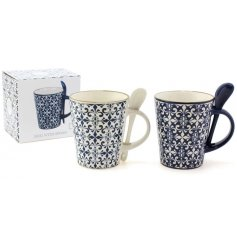An assortment of 2 blue and white mosaic pattern mugs with spoons