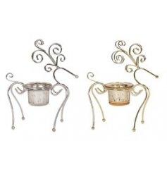 An assortment of 2 gold/silver reindeer tealight holders