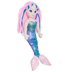 A beautiful plush mermaid soft toy, complete with long flowing locks and a shiny tail