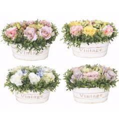 A beautiful assortment of coloured roses, sweetly placed inside a chic oval planter