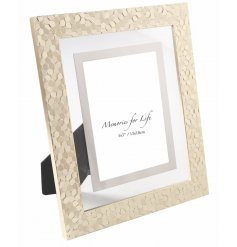 Bring a chic luxe tone to your home space with this golden hexagonal picture frame,