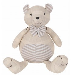 Add a classical vintage tone to your home spaces with this fabric teddy doorstop