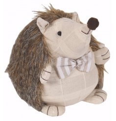 Add a classical vintage tone to your home spaces with this fabric hedgehog doorstop