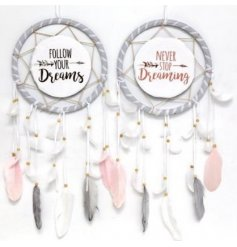 An assortment of pink/grey dreamcatchers with inspirational quotes