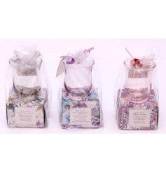 An assortment of 3 Les Fleurs Hurricane Tealight Holder & Tealights