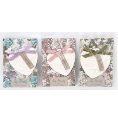 An assortment of 3 floral scented clay hearts.