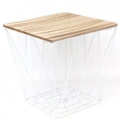 This small table featuring a natural toned square wood top and bold geometric white wire base is a must-have item
