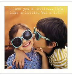 A greeting card with I love you a lottle quote