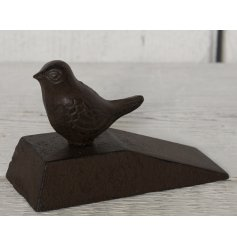 A simple and rustic inspired door wedge, set with its rustic features and permanently perched birdie