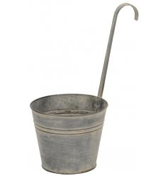 Bring a rustic edge look to your garden spaces with this chic white washed metal hanging planter