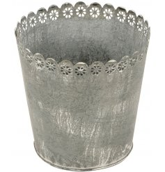 Add a distressed rustic edge to your garden spaces with this small metal planter
