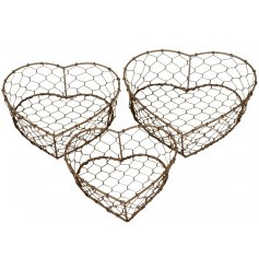 A distressed themed set of sized wire heart baskets will add a rustic edge to any home or garden space