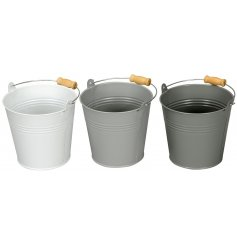 An assortment of 3 grey toned buckets