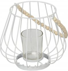 This chic and simple metal tlight holder with an added beaded handle will sit perfectly in any themed space of the home