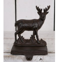 Add a rustic and distressed edge to your christmas decor this year with this cast iron Reindeer Stocking Holder