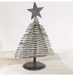A rustic willow branch Christmas tree with a star topper. A stylish festive item with a touch of silver sparkle.