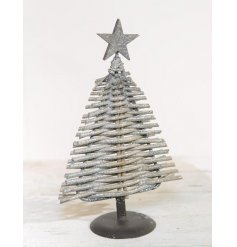A rustic willow Christmas tree with a silver glitter dusting. Complete with a festive star. A charming decoration.