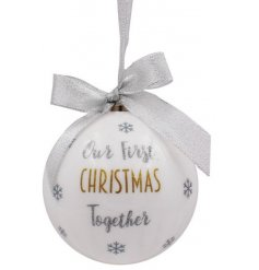 A beautiful and sleek bauble hanging from a glittered silver ribbon