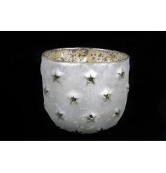 A medium sized Silver/Gold Star Candle Holder