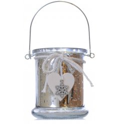 A Silver Lantern With Heart & Snowflake Charm