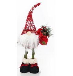 A nordic style standing Santa decoration with a snowflake knitted hat and bag of festive goodies.