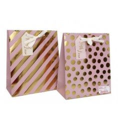 An assortment of 2 Pink & Gold medium Gift Bags