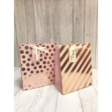 An assortment of 2 Pink & Gold medium Gift Bags