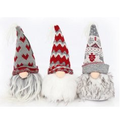 An assortment of 3 Christmas gonks, each with knitted hats in festive red and grey colours.