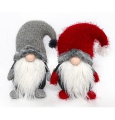 A mix of 2 red and grey knitted gonks with long white beards.
