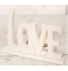 With its written love wording and smooth glazed finish, this chic tlight holder is a must have in any themed home