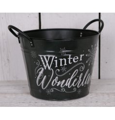 Bring home a chilly winter touch with this stylish black metal planter with an added snowflake decal